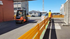 Worker is safely protected from forklift traffic with new barrier